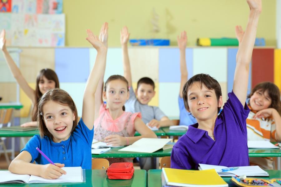 elementaryschoolstudentsraisinghandsinclassroom-_1